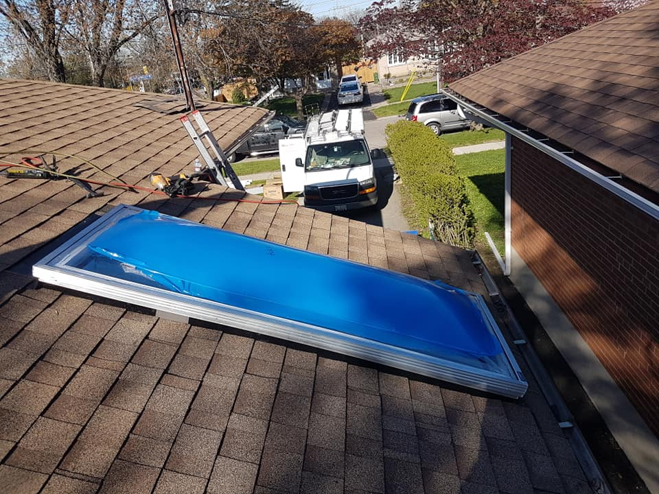 Skylight and Shingle Roof Replacement